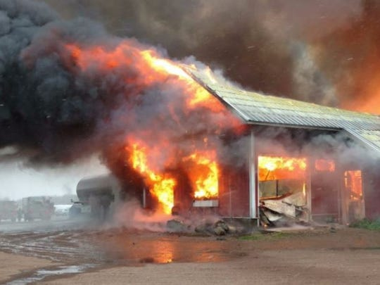 A fire destroys the Peterson family's milking parlor on Nov. 1.