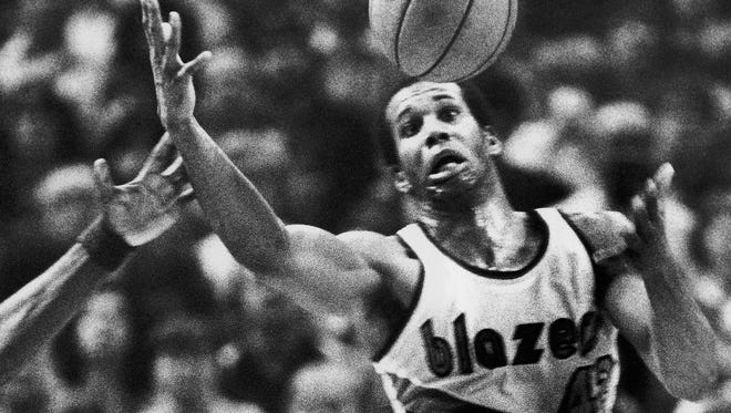 The Portland Trail Blazers'  Kermit Washington gains control of a loose ball against the Golden State Warriors on Dec. 25, 1979.