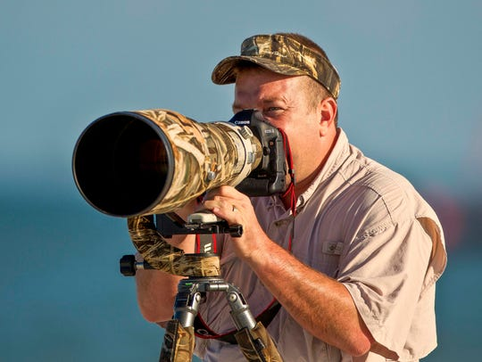 Wildlif e photographer Dennis Goodman.
