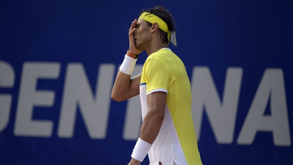 Rafael Nadal reacts after losing a point at the ATP