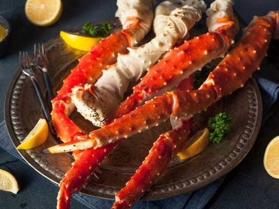Cooked organic Alaskan king crab legs with butter.