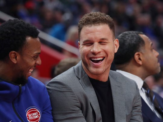 Detroit Pistons forward Blake Griffin, right, smiles