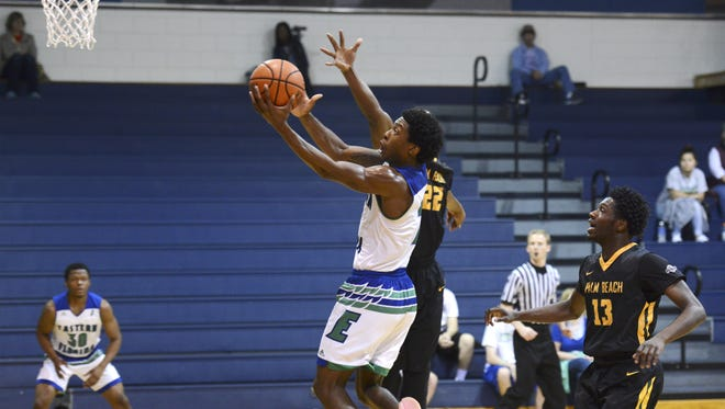 Eastern Florida guard Kareem Brewton scores during a game against Palm Beach State. Brewton announced he will sign with Memphis.