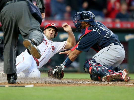 Cincinnati Reds left fielder Adam Duvall (23) slides in safely at home in the fifth inning during the National League baseball game between the Atlanta Braves and the Cincinnati Reds, Wednesday, April 25, 2018, at Great American Ball Park in Cincinnati.