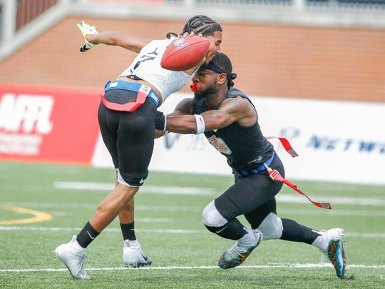 Fighting Cancer's Darrell Doucette (7) runs backwards to prevent The Money Team's Brandel Webb (1) from pulling his flag during the Fighting Cancer vs The Money Team American Flag Football League game at Bud and Jackie Sellick Bowl on Saturday, July 14, 2018.