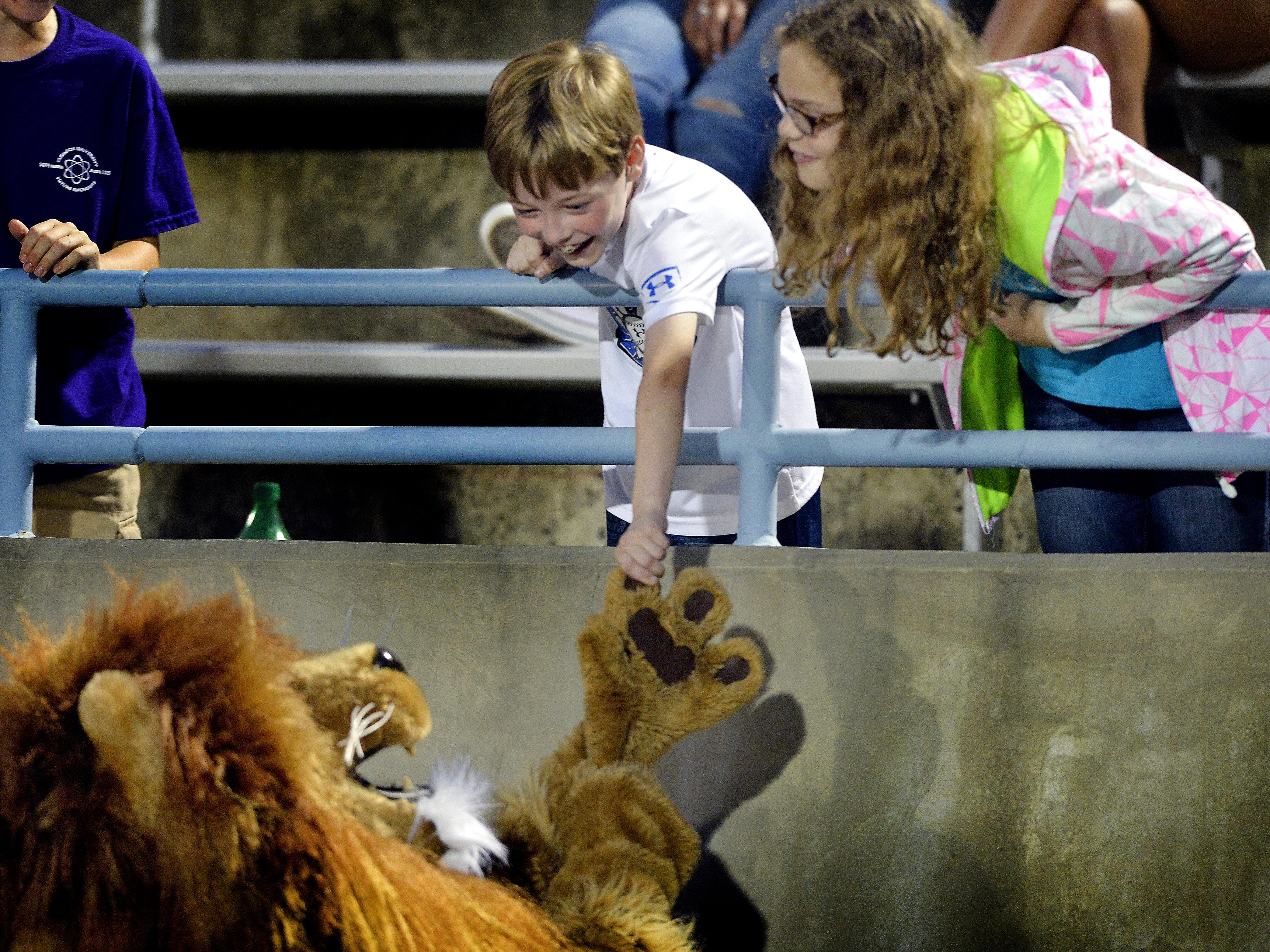 """Senior Ben Smith is the Daniel Lion mascot. """"It's fun seeing the little kids, how they react to you,"""" Smith said. """"I just try to make them happy."""""""