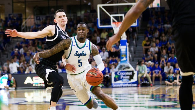 Zach Johnson, Florida Gulf Coast University guard, drives down the court during the Atlantic Sun men's basketball tournament quarterfinal against USC Upstate at Alico Arena on Monday, February 26, 2018.