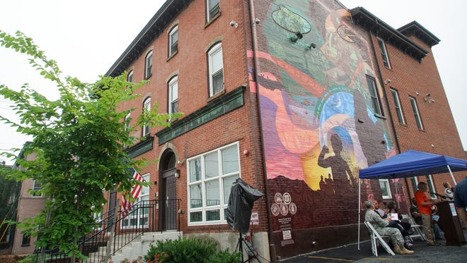 A mural designed by lead artist Eric Okdeh was dedicated by the Marcella's House in Wilmington on Tuesday morning.