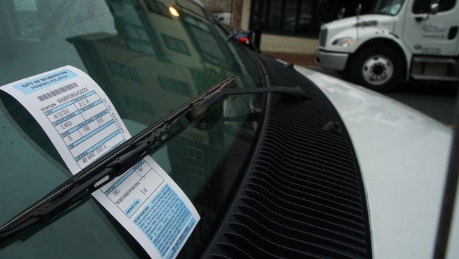A parking citation is posted on a vehicle on Market Street in Wilmington on Wednesday. Parking violations have been a reoccurring issue in the mayoral contest.