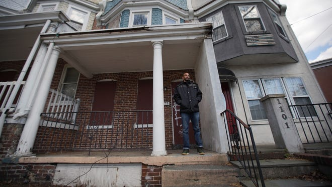 Eric Mundy stands in front of the property at 103 Oak St. where he worked as a trainee in the Interfaith Community Housing of Delaware's HomeWorks program, a pre-apprenticeship program for construction training. He felt he was in danger at the property because of the condition of disrepair.