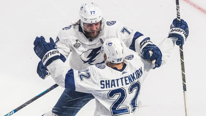 Tampa Bay Lightning defenseman Kevin Shattenkirk (22) celebrates his goal against the Dallas Stars with Victor Hedman (77) during overtime in Game 4 of the NHL hockey Stanley Cup Final, Friday, Sept. 25, 2020, in Edmonton, Alberta.