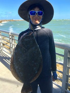 Nancy Tu of Orlando caught this 25-inch flounder Tuesday while fishing the seawall along North Jetty at Sebastian Inlet State Park. The jetty is closed for repairs.