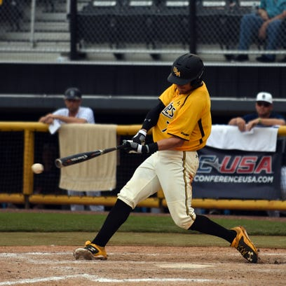 Southern Miss player Connor Barron, 7, swings at home