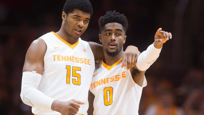 Tennessee forward Derrick Walker (15) and guard Jordan Bone (0) on the court during a game against Lipscomb on Dec. 9 at Thompson-Boling Arena.