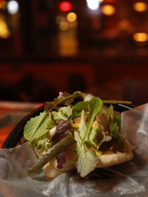 The rib eye bologna steamed bun from Hole in the Wall kitchen at Gas Lamp in Des Moines.