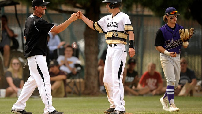 Abilene High's Doak Holloway (26) is congratulated by head coach Ryan Lewis  after hitting a triple in the bottom of the fourth inning of the Eagles' 7-3 win over Keller Timber Creek on Friday, April 28, 2017, at AHS's Blackburn Field.