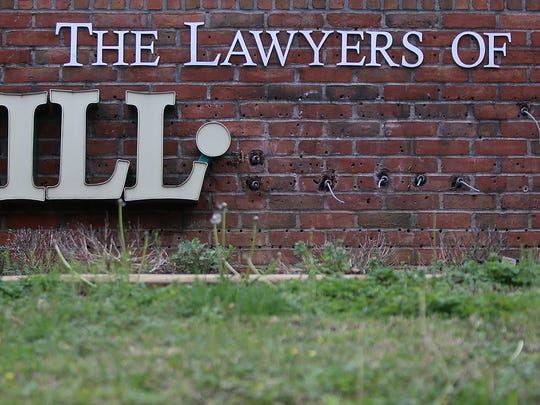 Outlines of the letters of 'Boren' can still be seen Monday after they were removed from the sign outside the Law Offices of T. Robert Hill in Jackson.