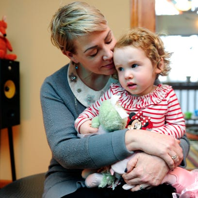 Joanna Montgomery holds her daughter, Magnolia, in