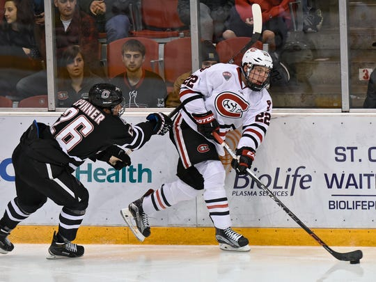 St. Cloud State's Jimmy Schuldt (22) skates with the puck during the Dec. 5  game at the Herb Brooks National Hockey Center in St. Cloud. Schuldt, a freshman from Minnetonka, has three goals and 12 points and is a plus-15 in 20 games for the Huskies.