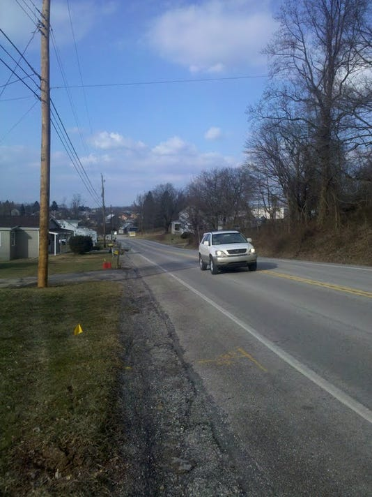 Three wrecks have occurred within six months on this stretch of Route 616. The utility pole on the left side is new. A driver ran off the road early Monday morning and snapped off the pole, residents said. (By Teresa Boeckel/York Daily Record/Sunday News)