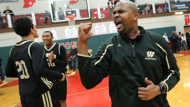 Warren Central head coach Greg Graham screams in celebration after they defeated Cathedral 47-44 with a last second shot by Djimon Henson inthe Class 4A IHSAA Sectional #10 held at Lawrence North High School on Tuesday, March 4, 2014.
