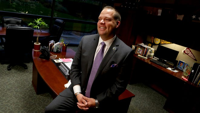 Bryan Barnett, 40, has been the mayor of Rochester Hills for two terms.  He had to become a write in candidate  for his re-election campaign due to the two-term limit that is written in the city charter. Barnett was photographed in his office at the Rochester Hills city hall on Wednesday, October 28, 2015.
