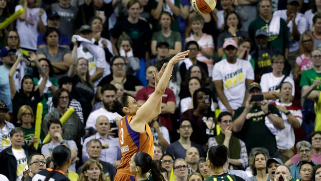 Subdued Seattle Storm fans look on as Phoenix Mercury's Diana Taurasi nails a 3-point shot with seconds left in the second half to send the game into overtime in a WNBA basketball playoff semifinal, Tuesday, Aug. 28, 2018, in Seattle. The Storm won 91-87 in overtime.