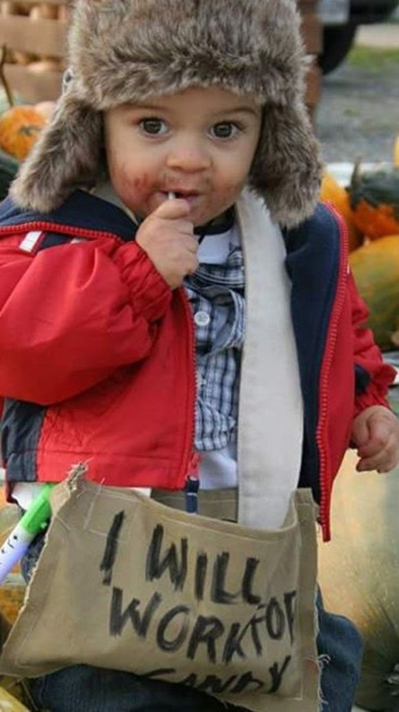 """This little kid """"will work for candy."""""""