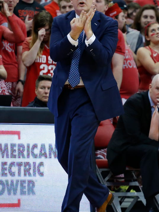 Rutgers head coach Steve Pikiell signals to his team against Ohio State during the first half of an NCAA college basketball game Tuesday, Feb. 20, 2018, in Columbus, Ohio. (AP Photo/Jay LaPrete)