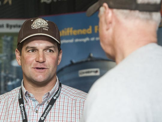Justin Nedens of Chief Industries, left, talks to customer Mike Lockman during the Grain Grower's Conference at Best Western Heritage Inn on Wednesday.