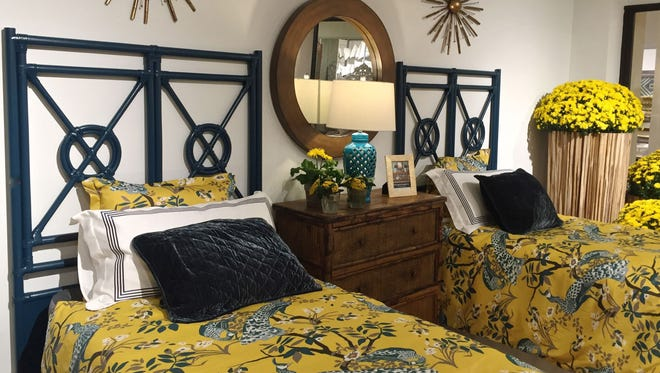 Kenian Furniture, a company known for its rattan and bamboo furniture, featured these twin beds at the Fall High Point Market.