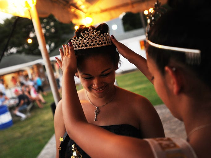 A crown is placed on Maura Renner's head after she is named Miss Carnival Queen on opening night of the 62nd Annual Wachapreague Fireman's Carnival on Wednesday, June 18, 2014.
