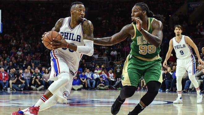 Philadelphia 76ers forward Robert Covington (33) dribbles the ball as Boston Celtics forward Jae Crowder (99) defends during the fourth quarter of the game at the Wells Fargo Center.