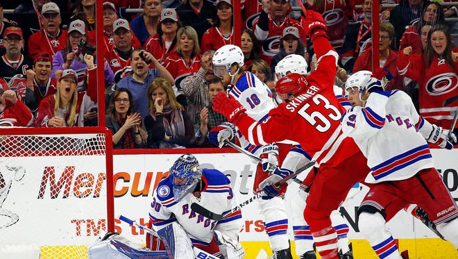 Carolina Hurricanes' Jeff Skinner (53) splits the defense to shoot the puck at New York Rangers goalie Henrik Lundqvist (30) for a goal during the first period of an NHL hockey game, Friday, Oct. 28, 2016, in Raleigh, N.C.