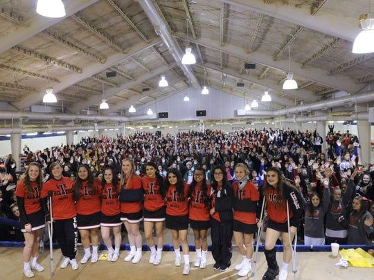 The Iraan cheerleaders stood in front of hundreds of cheerleaders from over 80 schools last year following a bus crash that took the life or Iraan cheerleading sponsor Liz Pope.