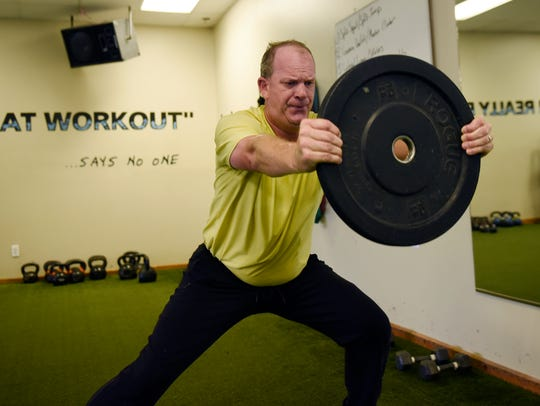 Tom Gillis works out at Xceleration Fitness in Auburn