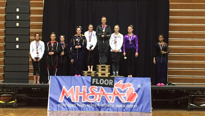 Brooke Allen, center, was the Level 2 floor champion at the state meet Saturday.