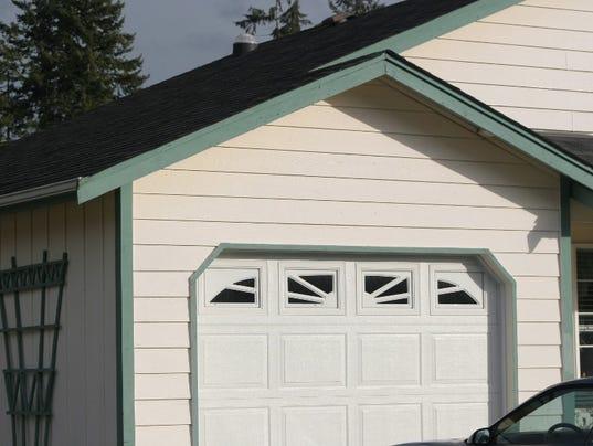 Garages versus green space in nutley for Bergen garage door