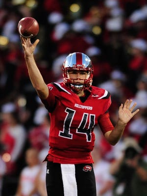 Sep 1, 2016; Bowling Green, KY, USA; Western Kentucky Hilltoppers quarterback Mike White (14) throws the ball during the first half against Rice Owls at Houchens Industries-L.T. Smith Stadium. Mandatory Credit: Joshua Lindsey-USA TODAY Sports