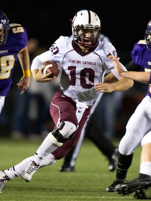 Dowling High School's Ryan Boyle (10) runs the ball into Johnston's Clayton Holcomb (45) in the first quarter Friday, Oct. 10, 2014, at Johnston High School.