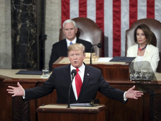FILE - In this Feb. 5, 2019, file photo, President Donald Trump delivers his State of the Union address to a joint session of Congress on Capitol Hill in Washington, as Vice President Mike Pence and Speaker of the House Nancy Pelosi, D-Calif., watch. Two decades ago, President Bill Clinton delivered his State of the Union address before a nation transfixed by his impeachment. He didn't use the I-word once. President Donald Trump is far from the first president to deliver a State of the Union address in a time of turmoil. (AP Photo/Andrew Harnik, File)