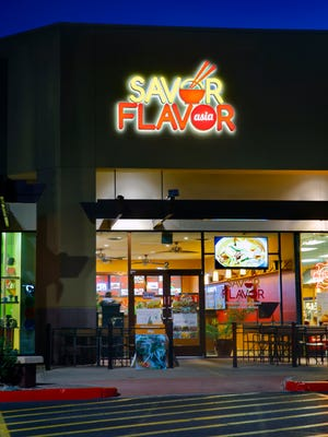 The outside of Savor Flavor Asia in Phoenix includes three tables on the front patio that allow for people-watching while you debate which movie to see.