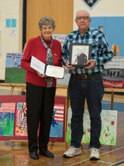 Kathleen Coonrod Goldsberry, sister of Navy veteran Glenn Coonrod, holds the diploma issued to her brother from the former Frankfort High School almost seven decades after he left the school early to join the Navy during the Korean War. Goldsberry's classmate, Charles Clark, right, was instrumental in getting the diploma issued and is shown here holding a photo of Coonrod during the latter's Navy days.