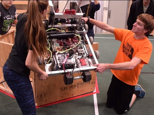 "Hotwire Robotics members prepare the team's prototype robot as early work begins on its FIRST Robotics ""Steamworks"" challenge."