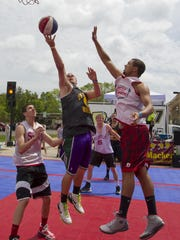 Teams play in the Gus Macker 3-on-3 basketball tournament