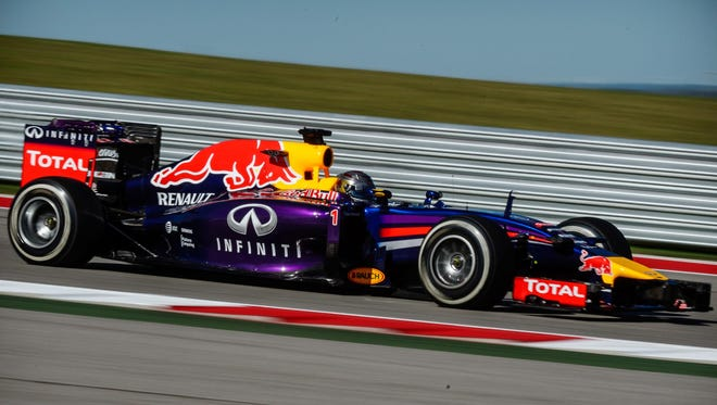 Red Bull Racing driver Sebastian Vettel (1) of Germany during practice for the 2014 U.S. Grand Prix at Circuit of the Americas. As penalty for using a sixth complete engine this season, Vettel will start from pit lane Sunday.
