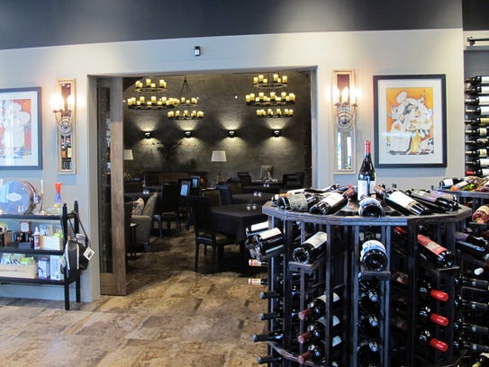 A broad door connects The Cave Bistro & Wine Bar with