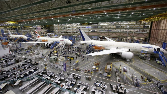 A line of Boeing 787 jets nears completion May 29, 2013, on the floor of the company's production plant in Everett, Wash.