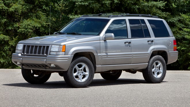 This 1998 Jeep Grand Cherokee is among 1.56 million Jeeps that Chrysler Group agreed last June to recall, but only now is preparing to make trailer hitches that are called for in the recall.