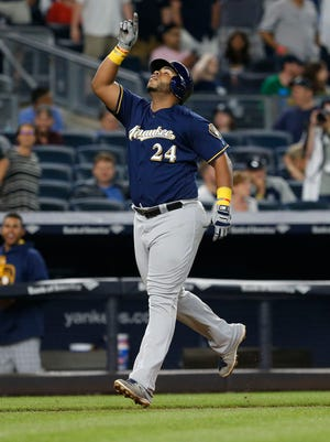 Brewers first baseman Jesus Aguilar rounds the bases after hitting a grand slam off the Yankees' Tyler Clippard in the seventh inning at Yankee Stadium.
